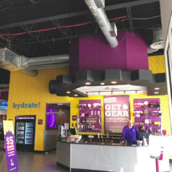 Image of a Planet Fitness interior, showing the front desk.